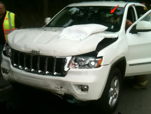 Figure 1: Wrecked up Jeep Cherokee with scary spider mark from Chode's head.